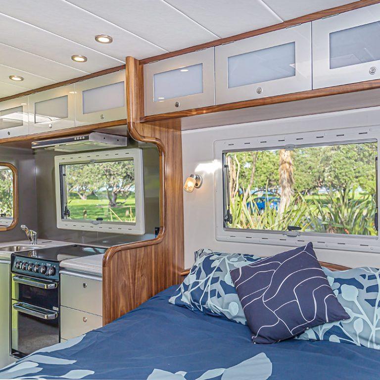 Origin-Motorhome-bedroom-kitchen